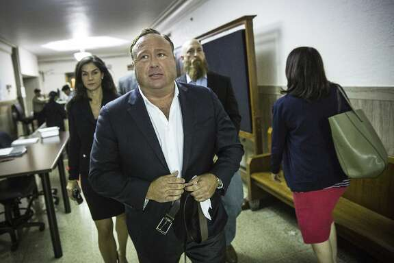 """In this Monday, April 17, 2017 photo, """"Infowars"""" host Alex Jones arrives at the Travis County Courthouse in Austin, Texas. Jones, the right-wing radio host and conspiracy theorist, is a performance artist whose true personality is nothing like his on-air persona, according to a lawyer defending the """"Infowars"""" broadcaster in a child custody battle. (Tamir Kalifa/Austin American-Statesman via AP)"""
