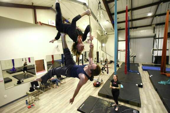 Joshua Grohman and Jenny Franckowiak work out at Aerial Horizon, which is an aerial dance company, in a new facility on Saturday, April 14, 2018.