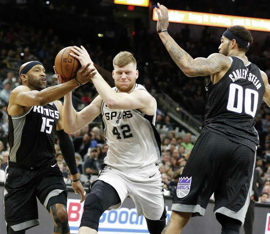 San Antonio Spurs center Davis Bertans (42) looks for room between Sacramento Kings guard Vince Carter (15) and center Willie Cauley-Stein (00) during first half action Monday April 9, 2018 at the AT&T Center. Photo: Edward A. Ornelas, Staff / San Antonio Express-News / © 2018 San Antonio Express-News