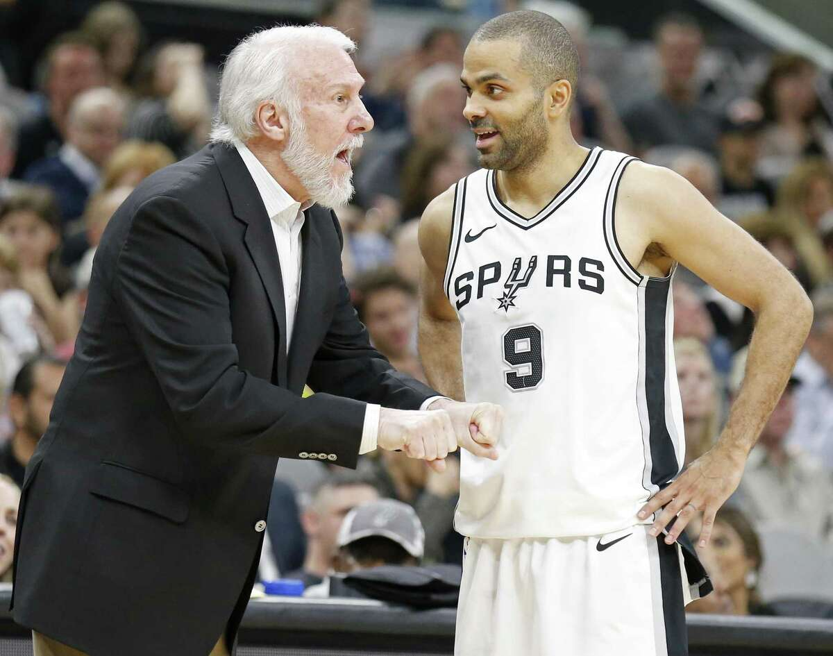 San Antonio Spurs head coach Gregg Popovich talks with guard Tony Parker (9) during first half action against the Sacramento Kings Monday April 9, 2018 at the AT&T Center.