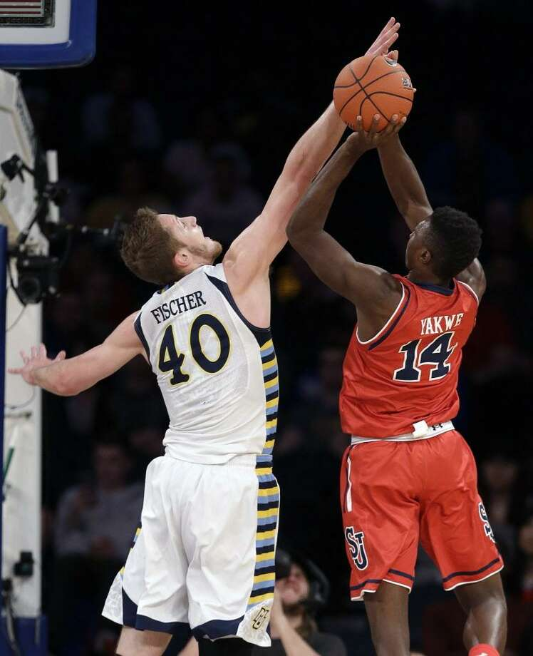 St. John's forward Kassoum Yakwe, right, shoots against Marquette's Luke Fischer in a Big East tournament game March 9, 2016, in New York. Photo: Julie Jacobson / Associated Press / Copyright 2016 The Associated Press. All rights reserved. This material may not be published, broadcast, rewritten or redistribu