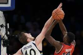 St. John's forward Kassoum Yakwe, right, shoots against Marquette's Luke Fischer in a Big East tournament game March 9, 2016, in New York.