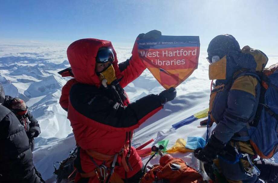 Lhakpa Sherpa holds a flag from West Hartford, Conn., on top of Mount Everest last year. She plans to climb it again this month. Photo: Associated Press 2017