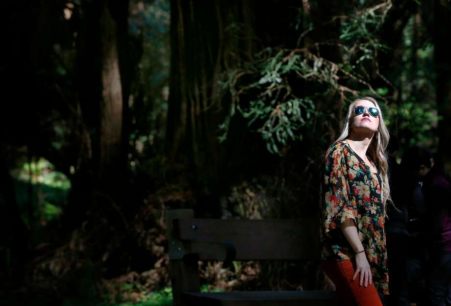Visiting from Boston, Alissa Gutowski takes in the view of old growth redwoods at Muir Woods National Monument in Mill Valley, Calif. on Tuesday, April 17, 2018. Gutowski, traveling with her friend Heather Ford, said redwood trees and the Golden Gate Bridge were the two must-sees during their visit. The Save the Redwoods League has released its first ever State of Redwoods Conservation Report. Photo: Paul Chinn / The Chronicle