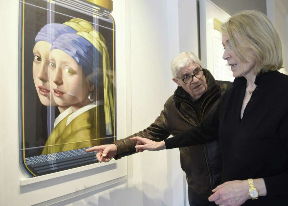 "Serge Clement and Marina Kamena, Parisians now based in Westport, show their piece Vermeer Replica 9PL"" on display at Gilles Clement Gallery in Greenwich, Conn. Tuesday, April 17, 2018. Serge Clement and Marina Kamena have been making collaborative art in the contemporized spirit of Renaissance ateliers for over twenty years and their work is now on display at the Gilles Clement Gallery. Photo: Tyler Sizemore / Hearst Connecticut Media / Greenwich Time"