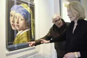 "Serge Clement and Marina Kamena, Parisians now based in Westport, show their piece Vermeer Replica 9PL"" on display at Gilles Clement Gallery in Greenwich, Conn. Tuesday, April 17, 2018. Serge Clement and Marina Kamena have been making collaborative art in the contemporized spirit of Renaissance ateliers for over twenty years and their work is now on display at the Gilles Clement Gallery."