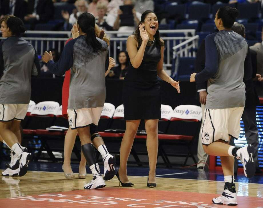 UConn assistant coach Marisa Moseley greets player Kia Stokes at the start of a game against DePaul on Dec. 19, 2014, in Bridgeport. Photo: Jessica Hill / Associated Press / FR125654 AP