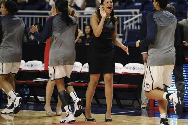 UConn assistant coach Marisa Moseley greets player Kia Stokes at the start of a game against DePaul on Dec. 19, 2014, in Bridgeport.