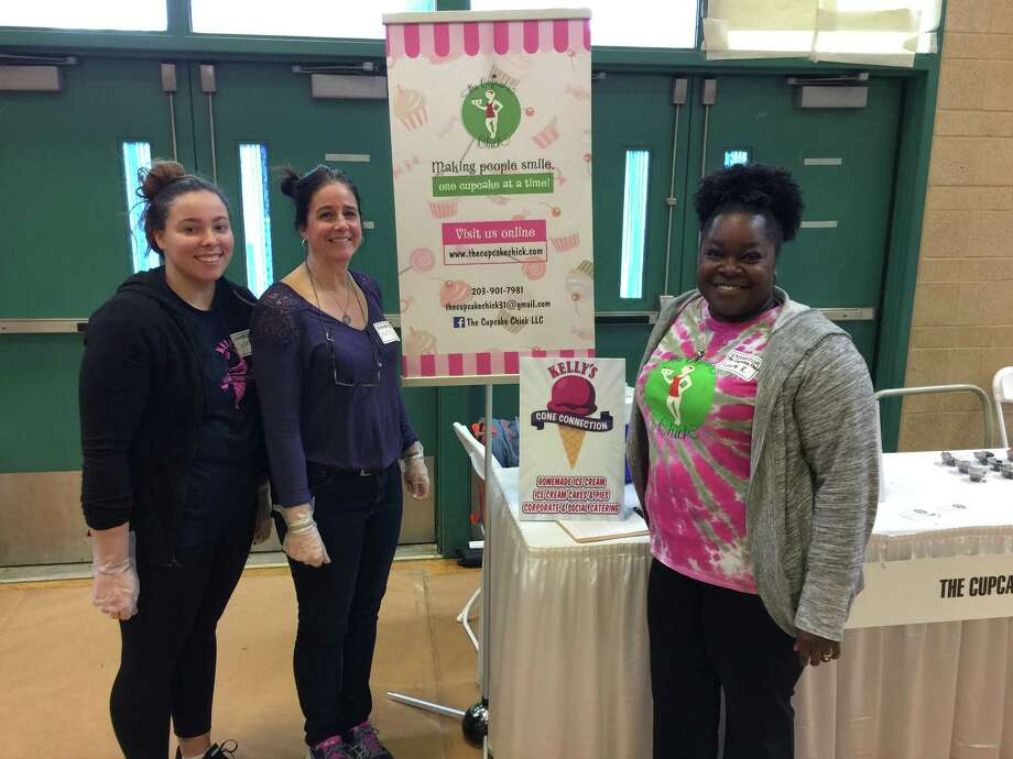 The annual Business & Community Expo organized by the Hamden Regional Chamber of Commerce was held Tuesday at Hamden High School. Above, Casey Bonilla and Kelly Ciccone of Kelly's Cone Connection and Lynette Weaver Rosenberger of The Cupcake Chick. Photo: Ben Lambert / Hearst Connecticut Media /