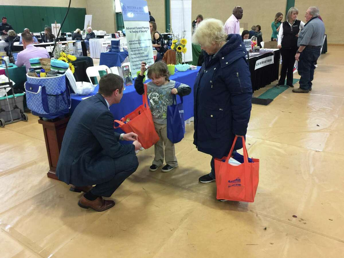 The annual Business & Community Expo organized by the Hamden Regional Chamber of Commerce was held Tuesday at Hamden High School. Above, A.J. Erickson, funeral director with Beecher & Bennett Funeral Service, talks with Nicky Church and Mary Ann Rasch.