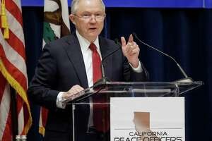 """FILE - In this March 7, 2018, file photo, U.S. Attorney General Jeff Sessions addresses the California Peace Officers' Association at the 26th Annual Law Enforcement Legislative Day in Sacramento, Calif. Since the Sessions-led Department of Justice sued California last month over its so-called """"sanctuary state"""" law limiting police collaboration with immigration agents, at least a dozen local governments have voted to either join or support the lawsuit or for resolutions opposing the state's position. (AP Photo/Rich Pedroncelli, File)"""
