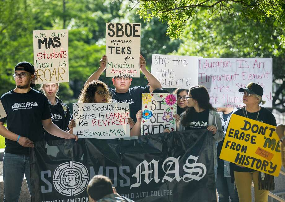 """People rally in front of the State Board of Education building before a preliminary vote on whether to create a statewide Mexican American studies course during a public hearing on Wednesday, April 16, 2018, in Austin, Texas. The board's discussion devolved into a debate on """"hyphenated Americanism."""" Photo: Ricardo Brazziell /Associated Press / RICARDO B. BRAZZIELL / AMERICAN-STATESMAN"""