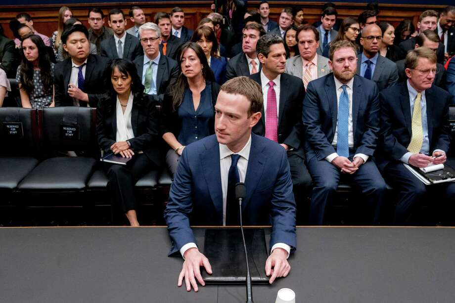Facebook CEO Mark Zuckerberg arrives to testify before a House Energy and Commerce hearing April 11 on Capitol Hill in Washington, about the use of Facebook data to target American voters in the 2016 election and data privacy. Photo: Andrew Harnik /Associated Press / Copyright 2018 The Associated Press. All rights reserved.