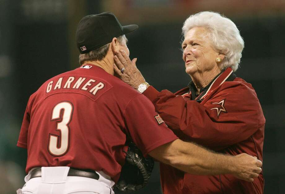 Former First Lady Barbara Bush, seen here with then-Astros manager Phil Garner during the 2004 NLCS, was a loyal backer of Houston sports teams over the years. She died Tuesday at age 92. Photo: Stephen Dunn/Getty Images