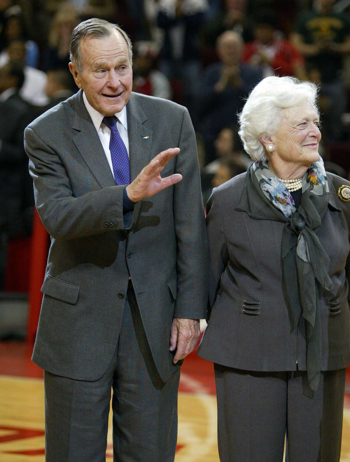 Former President George H.W. Bush and First Lady Barbara Bush receive a check for $200,000 from Toyota for the Bush-Clinton Fund to help victims of tsunami in south Asia at the Toyota Center, January 24, 2005 in Houston, Texas. (Photo by Bob Levey/WireImage)