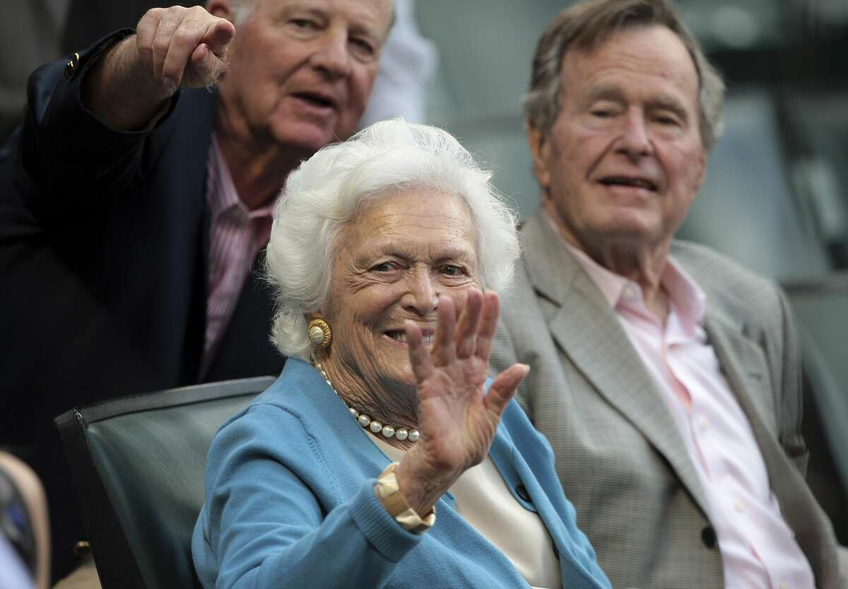 HOUSTON - APRIL 13: Former first lady Barbara Bush waives to friends as former President George H.W. Bush, right, and former Secretary of State James A. Baker III look on during a baseball game between the Chicago Cubs and the Houston Astros at Minute Maid Park on April 13, 2011 in Houston, Texas. (Photo by Bob Levey/Getty Images)