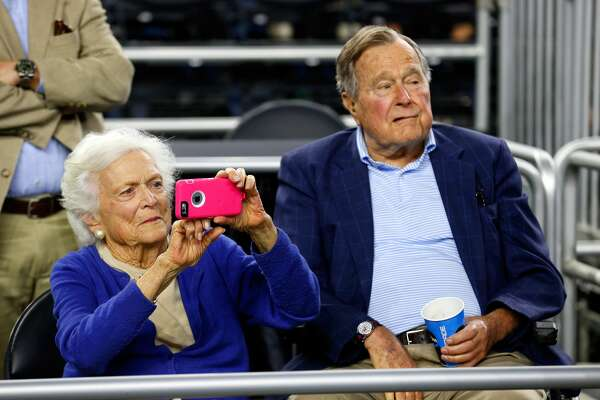 HOUSTON, TX - MARCH 29:  (L-R) Former First Lady Barbara Bush and former President George H.W. Bush look on prior to the South Regional Final of the 2015 NCAA Men's Basketball Tournament between the Duke Blue Devils and the Gonzaga Bulldogs at NRG Stadium on March 29, 2015 in Houston, Texas.  (Photo by Tom Pennington/Getty Images)