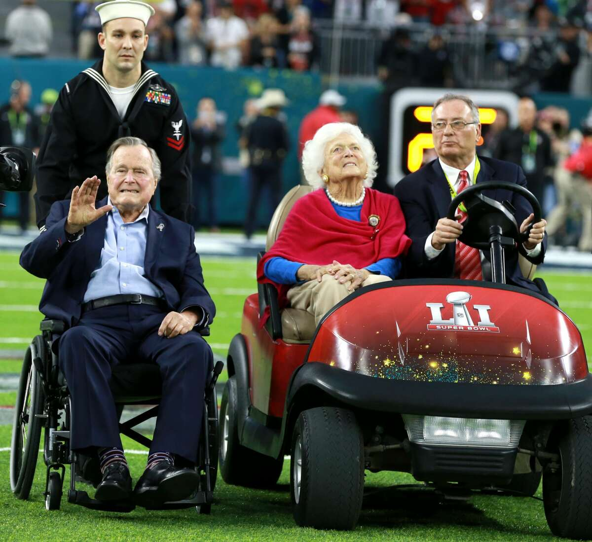 HOUSTON, TX - FEBRUARY 5: Former President George H.W. Bush and former First Lady Barbara Bush arrive for the coin toss during pregame activities at NRG Stadium before the Super Bowl. The Atlanta Falcons play the New England Patriots in Super Bowl LI at NRG Stadium in Houston on Feb. 5, 2017. (Photo by Jim Davis/The Boston Globe via Getty Images)