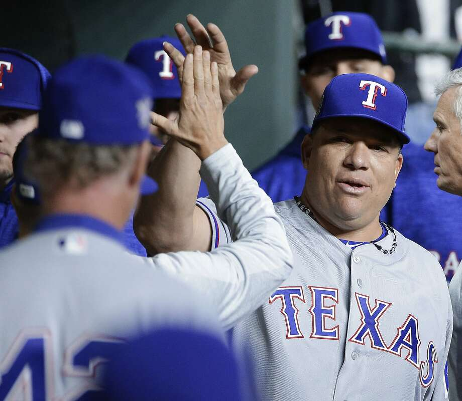 Texas Rangers starting pitcher Bartolo Guzman collects high fives in the dugout after pitching eight innings against the Houston Astros during a baseball game Sunday, April 15, 2018, in Houston. Photo: Michael Wyke / Associated Press