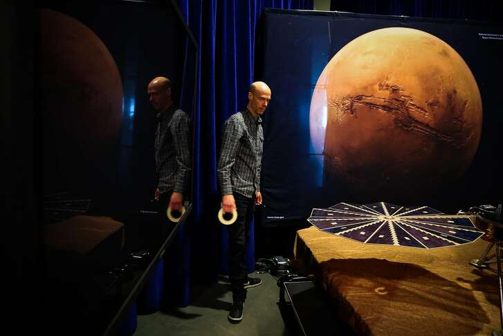 Rick Danielson helps set up the InSight Mars Lander Roadshow exhibit at the San Francisco Exploratorium in San Francisco, California, on Tuesday, April 17, 2018.