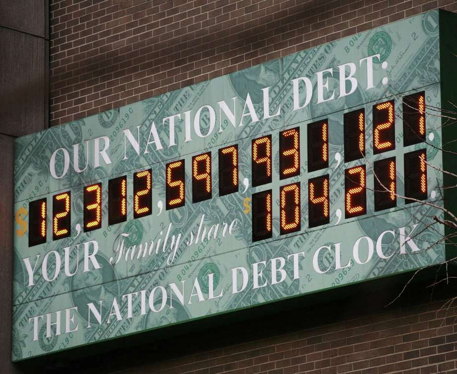 The National Debt Clock is shown on Feb. 1, 2010 in New York. The Debt Clock is a privately funded estimate of the national debt. Photo: Mark Lennihan, STF / AP / AP