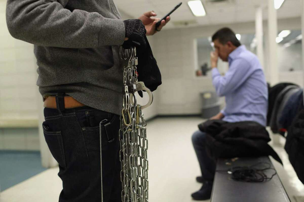 An Immigration and Customs Enforcement officer carries shackles for undocumented immigrants inside an ICE processing center on April 11 at the U.S. Federal Building in lower Manhattan, New York City. ICE detentions are especially controversial in New York, considered a