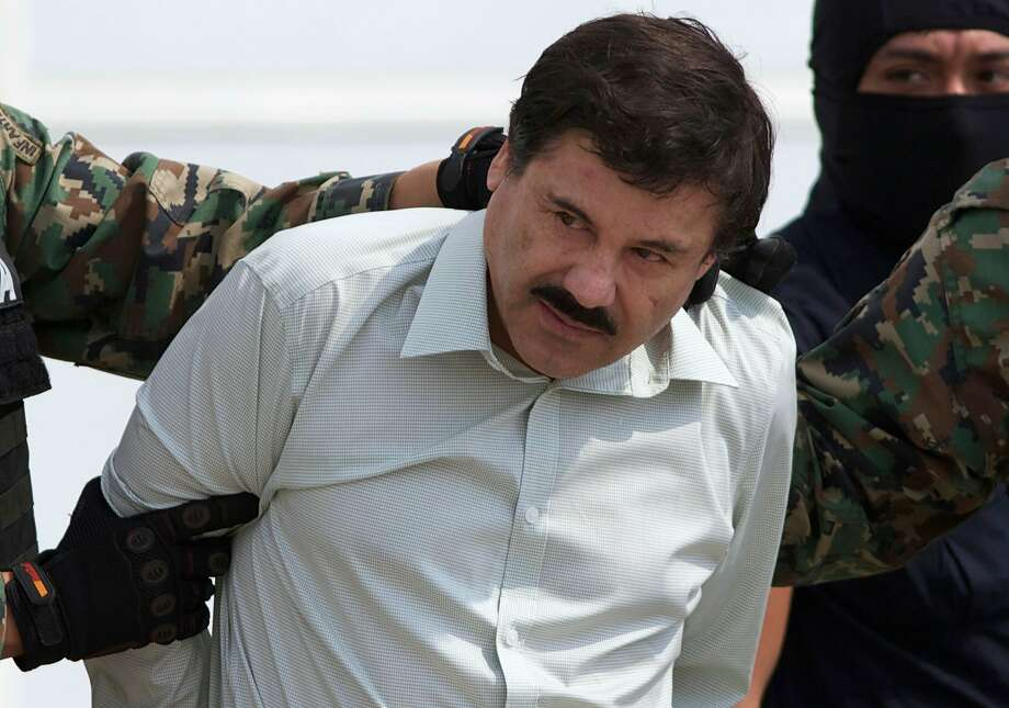 """FILE - This Feb. 22, 2014 file photo shows Joaquin """"El Chapo"""" Guzman, the head of Mexico's Sinaloa Cartel, being escorted to a helicopter in Mexico City following his capture overnight in the beach resort town of Mazatlan. Photo: Eduardo Verdugo, Associated Press"""