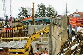 Construction work continues on the M-20 bridge on Tuesday afternoon. (Katy Kildee/kkildee@mdn.net)