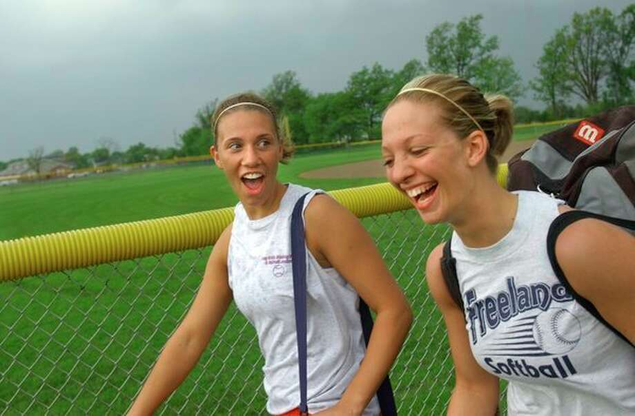 Freeland pitcher Stacy Delaney and catcher Sarah Glowacki share a laugh after practice during the 2003 season. (Daily News file photo)