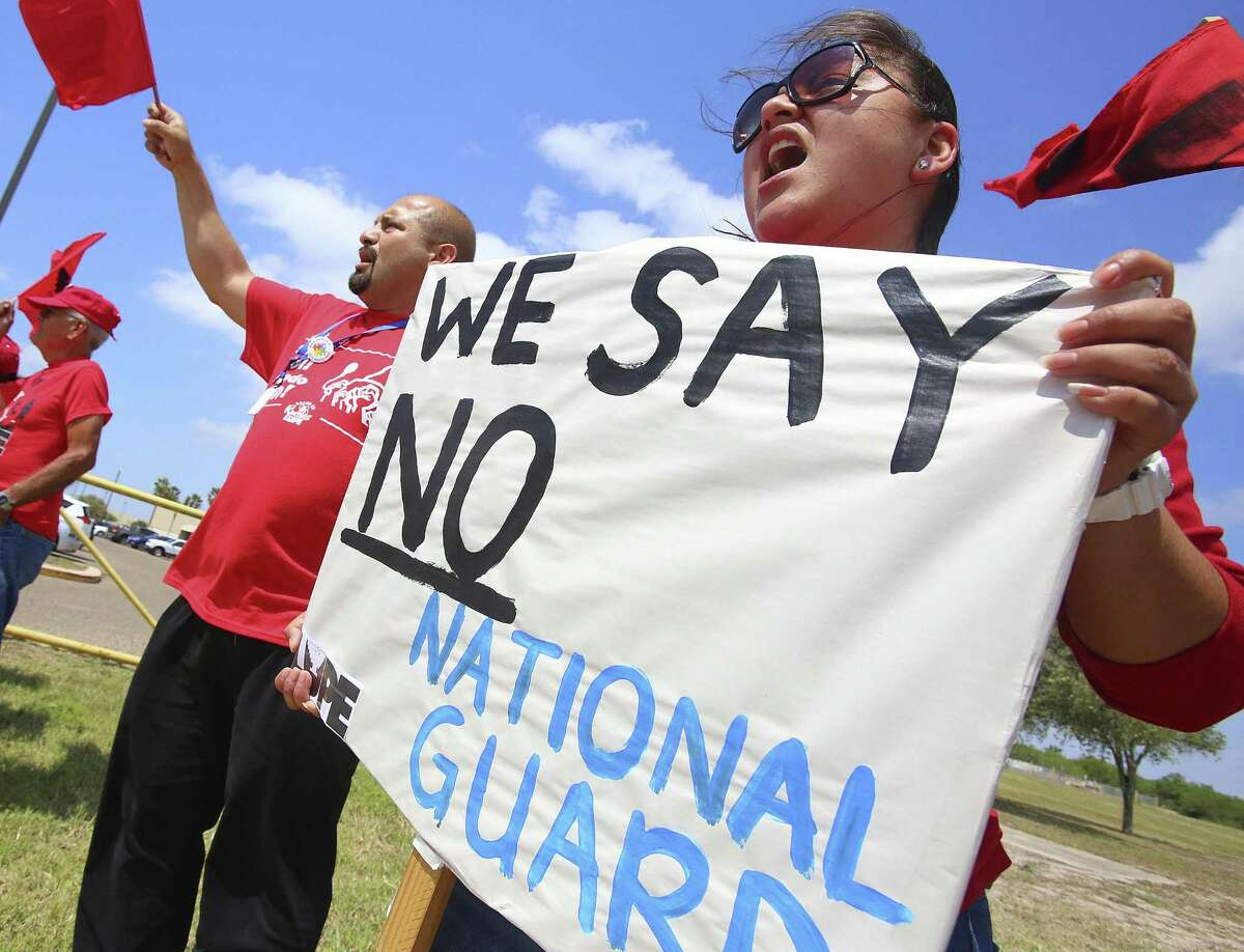 Protestors chant as Gov. Greg Abbott visits the Texas National Guard Armory on April 12 in Weslaco. Abbott announced that there will be an increase of 1,000 Texas National Guard on the southern border with Mexico.