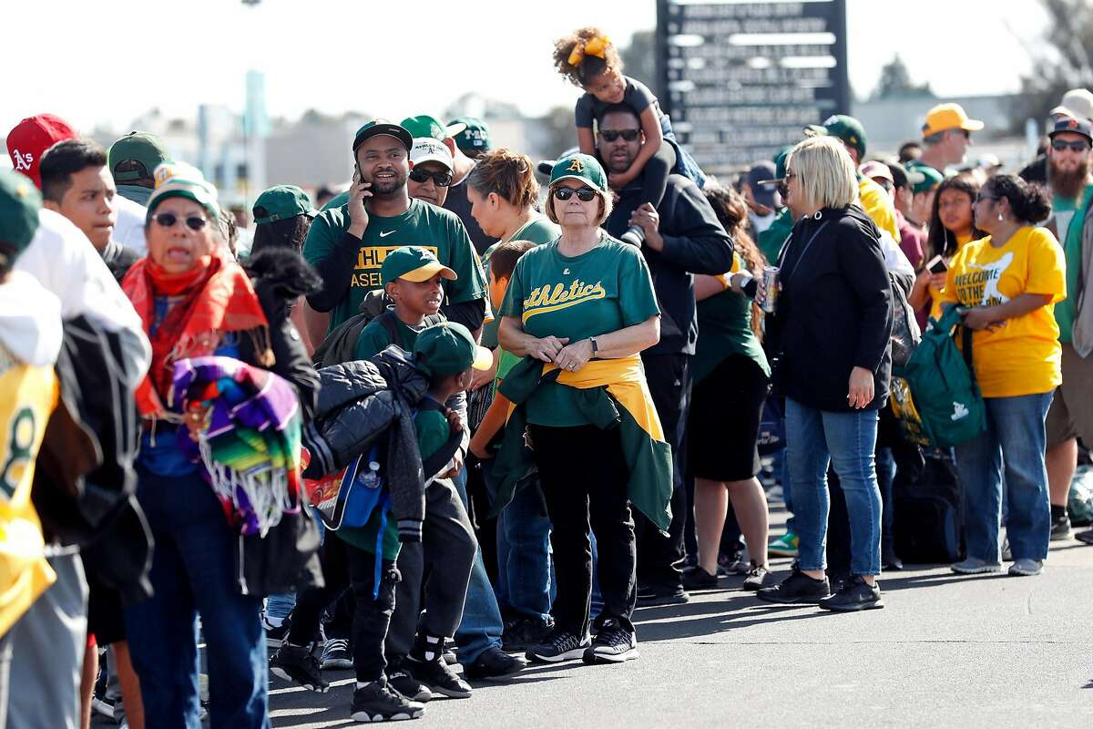 Oakland Athletics' fans line up on free ticket night to commemorate the 50th year of A's baseball in Oakland at Oakland Coliseum in Oakland, Calif., on Tuesday, April 17, 2018.