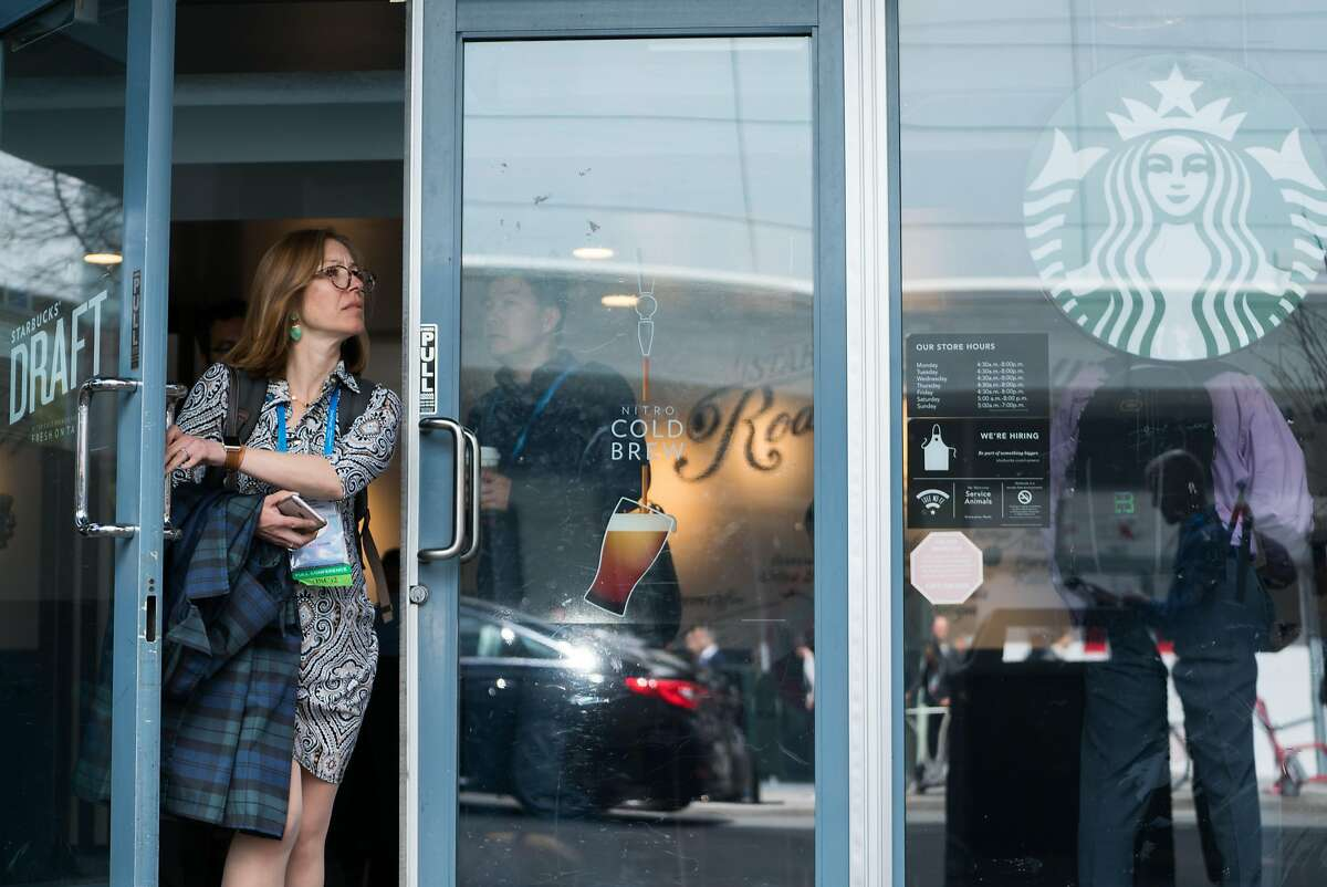 A woman exits a Starbucks coffee shop on 4th and Mission Streets in San Francisco, Calif. on Tuesday, April 17, 2018.