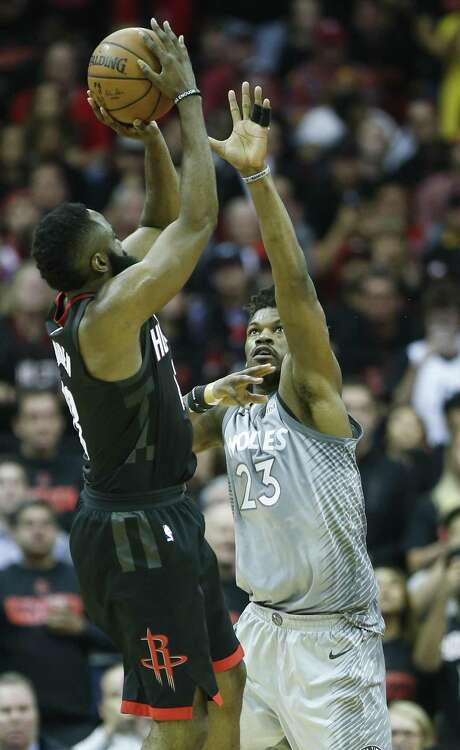 Minnesota Timberwolves guard Jimmy Butler (23) defends a shot by Houston Rockets guard James Harden (13) during the fourth quarter of Game 1 of an NBA basketball first-round playoff series at Toyota Center on Sunday, April 15, 2018, in Houston. ( Brett Coomer / Houston Chronicle ) Photo: Brett Coomer, Staff / Houston Chronicle / © 2018 Houston Chronicle