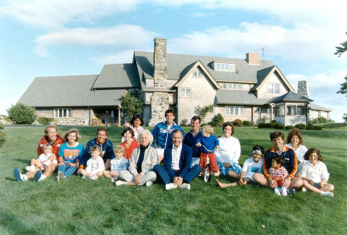 Portrait of the Bush family in front of their Kennebunkport, Maine August 24, 1986. BACK ROW: Margaret holding daughter Marshall, Marvin Bush, Bill LeBlond. FRONT ROW: Neil Bush holding son Pierce, Sharon, George W. Bush holding daughter Barbara, Laura Bush holding daughter Jenna, Barbara Bush, George Bush, Sam LeBlond, Doro Bush Lebond, George P. (Jeb's son), Jeb Bush holding son Jebby, Columba Bush, and Noelle Bush. (Photo by Newsmakers)