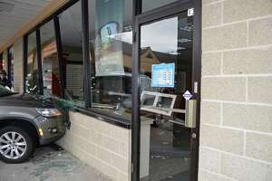 A 73-year-old woman hit the accelerator instead of the brake while pulling into a parking spot in Century Plaza in Monroe, Conn., crashing through the a storefront on April 17, 2018, officials said.