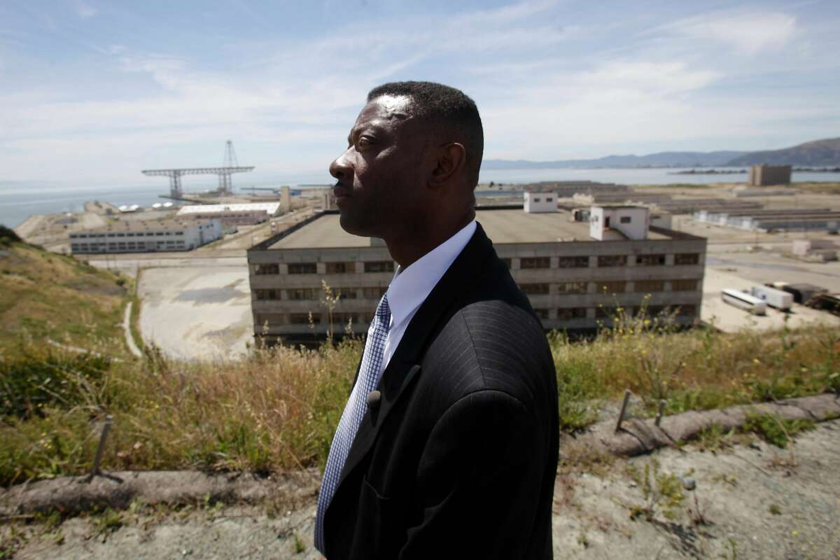 Kofi Bonner Regional Vice President Bay Area Division Lennar Urban, stands on top of the Hilltop community with the site of the proposed NFL stadium and other parts of the Hunters Point Shipyard redevelopment project behind him in San Francisco, Calif. on Wednesday June 2, 2010.