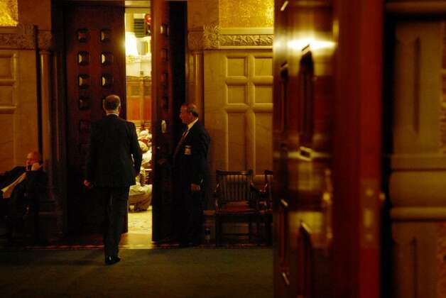 A Sergeant at Arms opens a side door to the floor of the Senate chambers for Sen. Michael Ranzenhofer during a Senate session at the Capitol  on Monday, June 21, 2010.   (Paul Buckowski / Times Union) Photo: PAUL BUCKOWSKI