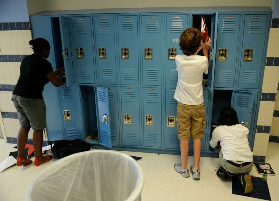 Eighth grade students at the Myers Middle School in Albany clean out their lockers, the annual rite of passage for the students who will begin as freshman in high school next year.   (Skip Dickstein/Times Union) Photo: Skip Dickstein / 2008