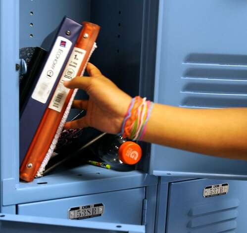 Eighth grader Ashadeya Davis removes items from her locker.   (Skip Dickstein/Times Union) Photo: Skip Dickstein / 2008