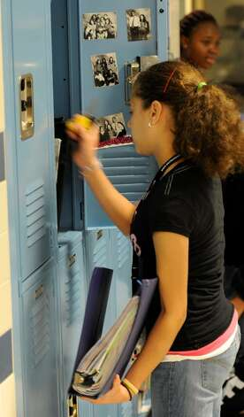Eighth grader Shaneska Sime removes items from her locker at the Myers Middle School in Albany, in preparation for her freshman year in high school next fall.   (Skip Dickstein/Times Union) Photo: Skip Dickstein