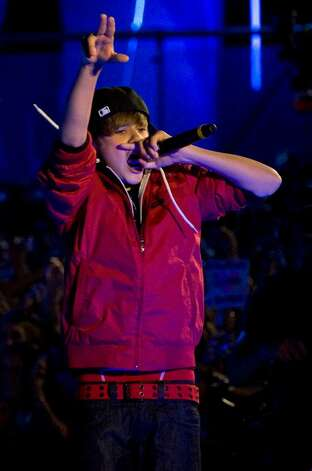 Justin Bieber performs during the MuchMusic Video Awards in Toronto, Sunday June 20, 2010.  (AP Photo/The Canadian Press, Adrien Veczan) Photo: Adrien Veczan