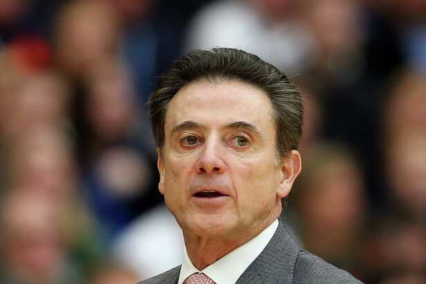 FILE - SEPTEMBER 27:Coach Rick Pitino and Athletic director Tom Jurich Let Go From Louisville - SYRACUSE, NY - MARCH 29:  Head coach Rick Pitino of the Louisville Cardinals looks on the first half of the game against the Michigan State Spartans during the East Regional Final of the 2015 NCAA Men's Basketball Tournament at Carrier Dome on March 29, 2015 in Syracuse, New York.  (Photo by Elsa/Getty Images) ORG XMIT: 527066623