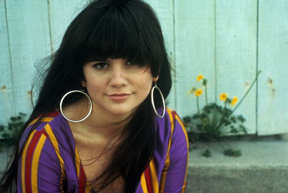 "Linda Ronstadt is seen in her Betsey Johnson singing dress that she wore for years. ""I always carried it wadded up in my purse in case the airlines lost our luggage,"" says Ronstadt. Photo: Henry Diltz"