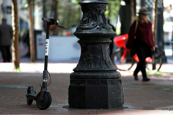 SAN FRANCISCO, CA - APRIL 17:  A Bird scooter sits parked on a street corner on April 17, 2018 in San Francisco, California. Three weeks after three companies started placing electric scooters on the streets for rental, San Francisco City Attorney Dennis Herrera issued cease-and-desist notice to electric scooter rental companies Bird, LimeBike and Spin. The notice comes as the San Francisco board of supervisors considers a proposed ordinance to regulate the scooters to keep people from riding them on sidewalks, parking them in the middle of sidewalks and requiring riders to wear helmets and have a drivers license.  (Photo by Justin Sullivan/Getty Images)