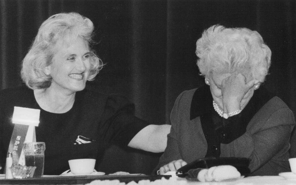 """Carter Castille, conference chairwoman for the 24th Texas Legislative Conference, looks on with laughter as First Lady Barbara Bush hides her face, showing her bashful side. Tom Loeffler was singing Bush's praises, as she was honored as the """"Texan of the Year"""" on March 23, 1990. San Antonio Express-News file photo"""