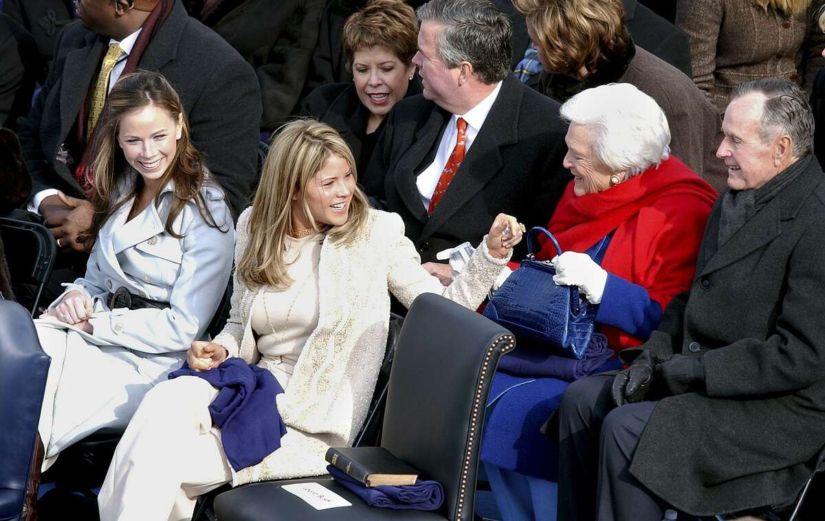 The Bush twins chat with their grandparents, former President George H. Bush and Barbara Bush before their dad is sworn into office for his second term Thursday.