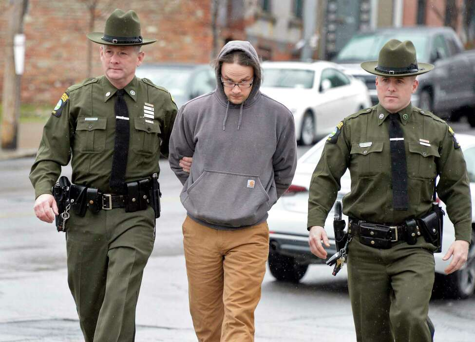 Town of Bolton's chief operator of its water department Thomas French II, is lead into Albany City Court by DEC officers George LaPoint, left, and Alan Brassard, right, to be arraigned on charges related to falsification of water-quality reports Tuesday April 17, 2018 in Albany, NY. (John Carl D'Annibale/Times Union)
