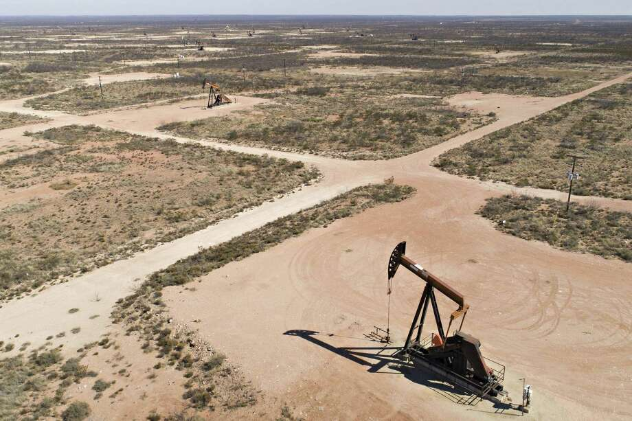 Pumpjacks operate on oil wells in the Permian Basin in this aerial photograph taken over Crane, Texas, on March 2, 2018.  NEXT: See scenes from the 2018 Permian Basin Oil Show. Photo: Daniel Acker, Stf / Bloomberg / Bloomberg