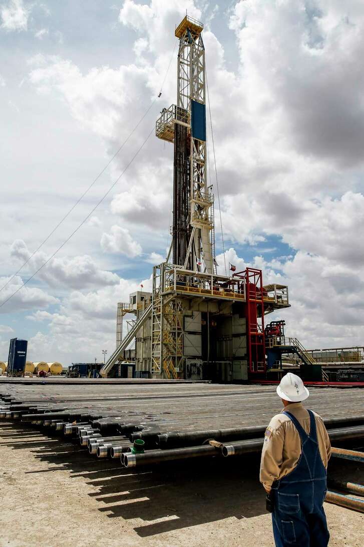 A drill rig sits on a pad site where it will drill three to six wells next to each other at a Chevron drilling and hydraulic fracturing site Wednesday, July 19, 2017 in Midland. ( Michael Ciaglo / Houston Chronicle )