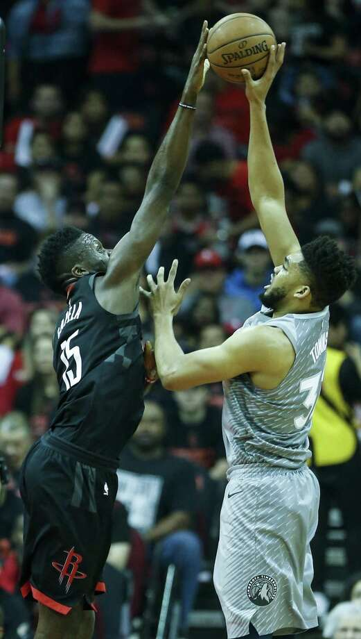 Rockets center Clint Capela, left, certainly got the best of the Timberwolves' Karl-Anthony Towns during Sunday's Game 1. Photo: Brett Coomer, Staff / Houston Chronicle / © 2018 Houston Chronicle